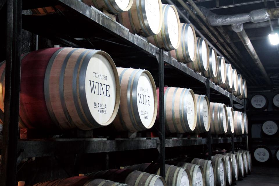 Free Wine barrels stacked in the old cellar of the winery