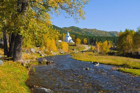 Free Autumn landscape with forest, hills and the church