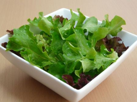 Free Green salad in a white bowl