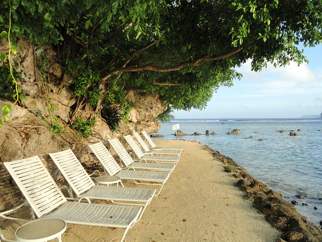Free guam beach sea ocean water trees chairs lounges
