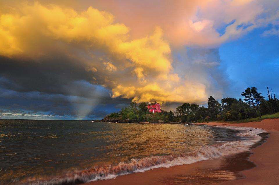 Free Marquette Lighthouse at sunset with thunderstorm clouds