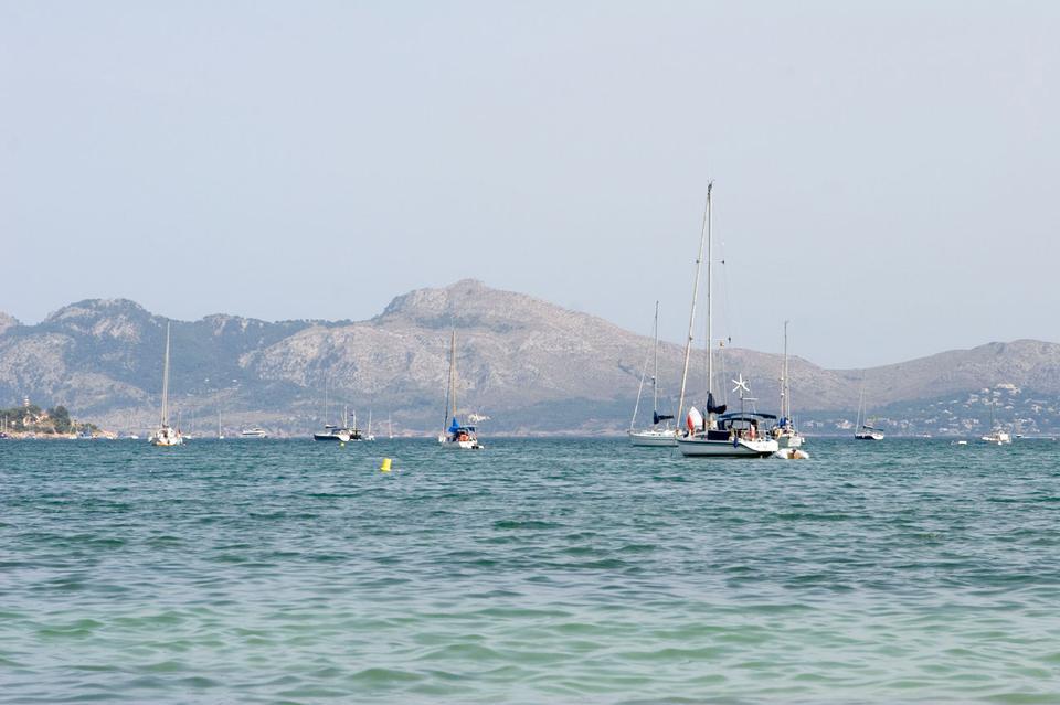 Free Sailboats idling in a Mediterranean bay