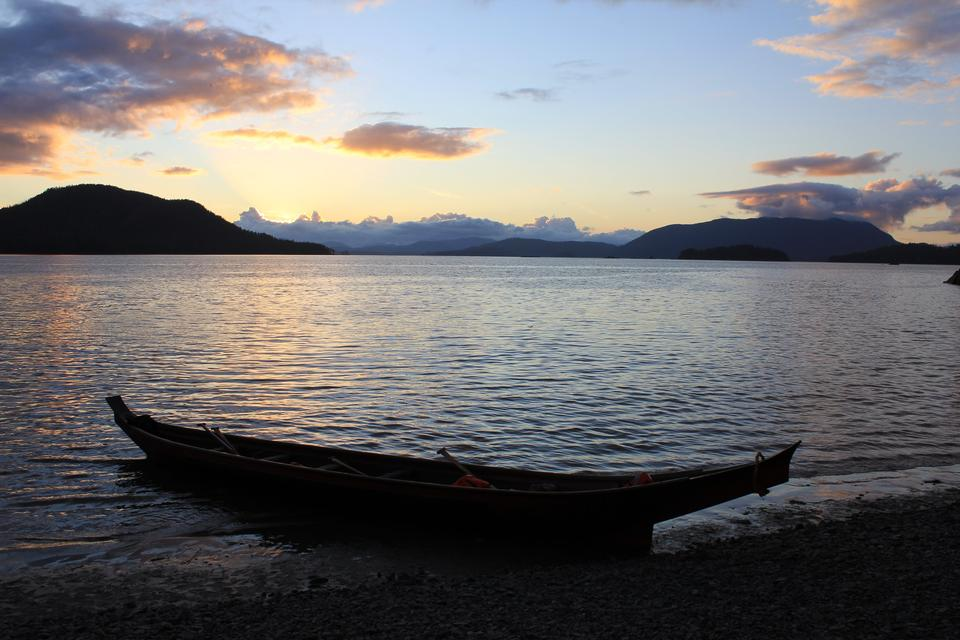 Free Tlingit Indian canoe in the sunset Alaska