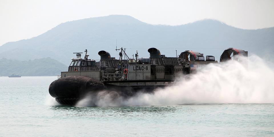 Free US Navy hovercraft carries vehicles and Marines