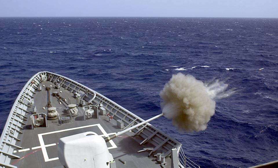 Free Fires its 5 inch gun at a target drone during a gun exercise