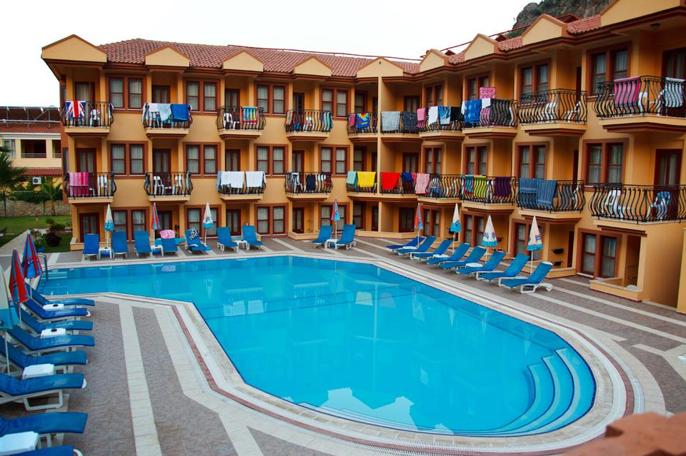 Free Small holiday hotel with pool early in the morning in Turkey