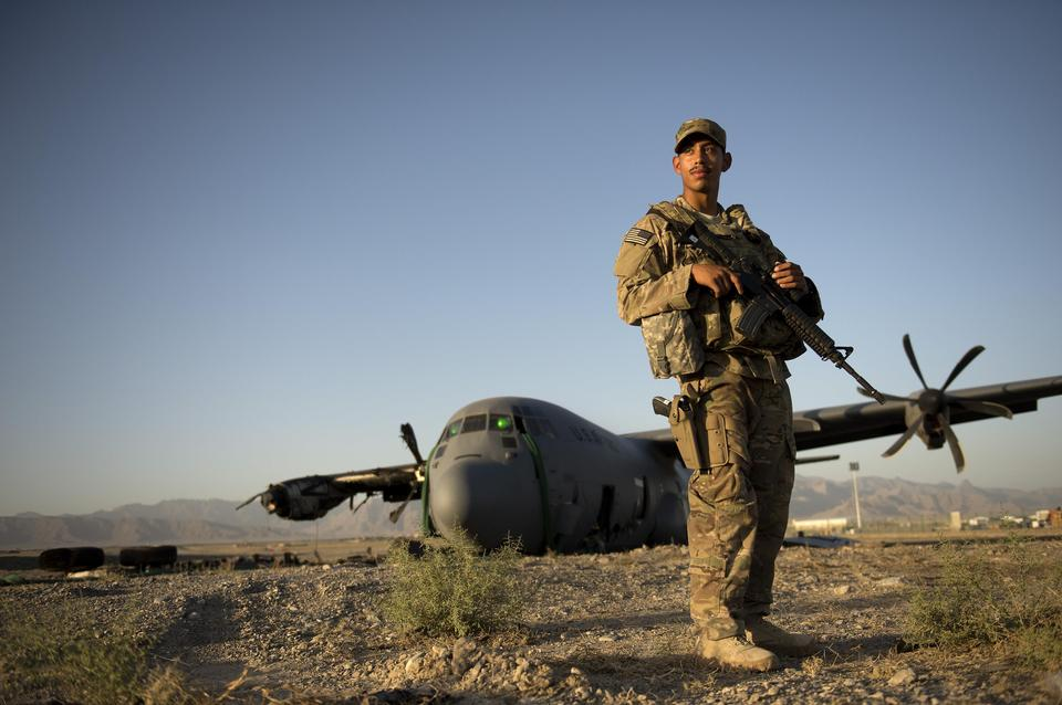 Free Christian Mejia Guards a Disabled C-130 Hercules
