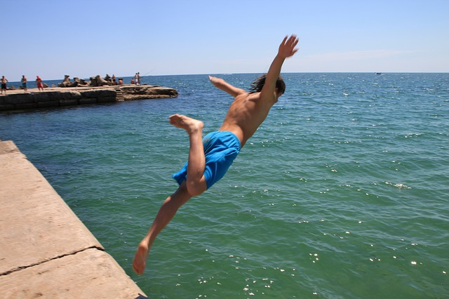 Free jump jumping man sea water wave people summer
