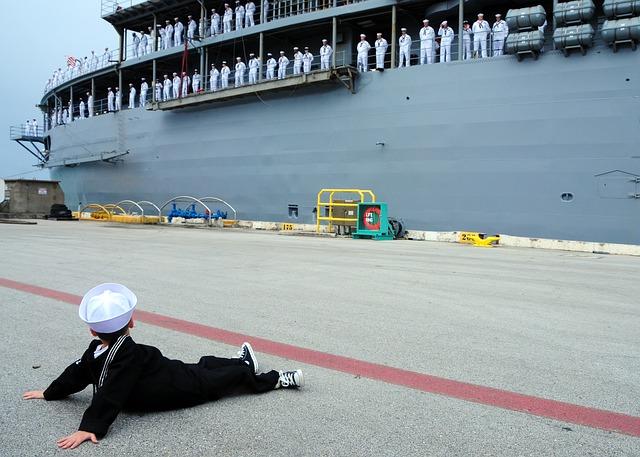 Free boy navy suit pier dock saying goodbye ship