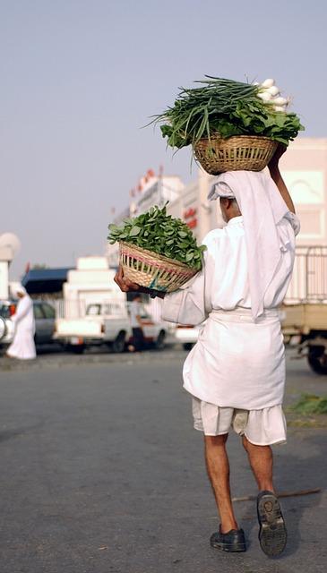 Free bahrain vegetables man carrying produce market