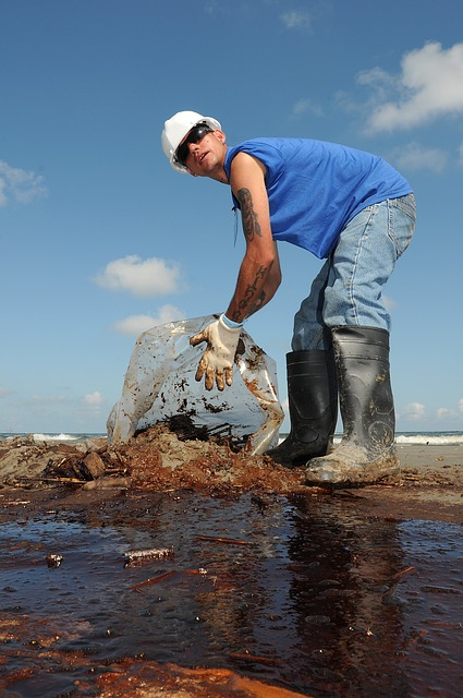 Free man worker oil cleanup sky clouds beach