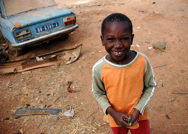 Free senegal child boy smiling dirt vehicle portrait