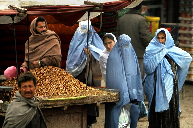 Free afghanistan women man market goods urban village
