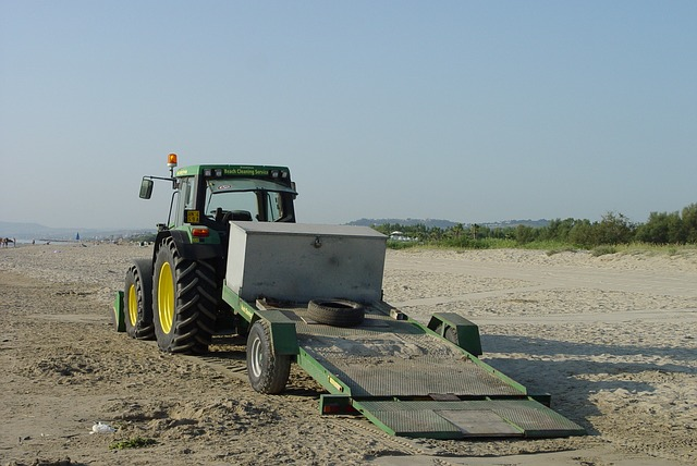Free beach tractor cleaning beaches