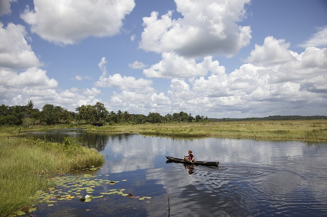 Free guyana sky clouds lake stream water man canoe