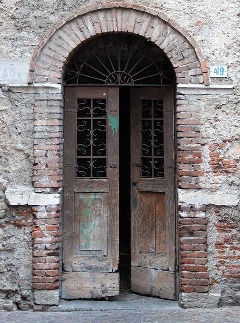 Free old doorway patched doors dilapidated brick arch