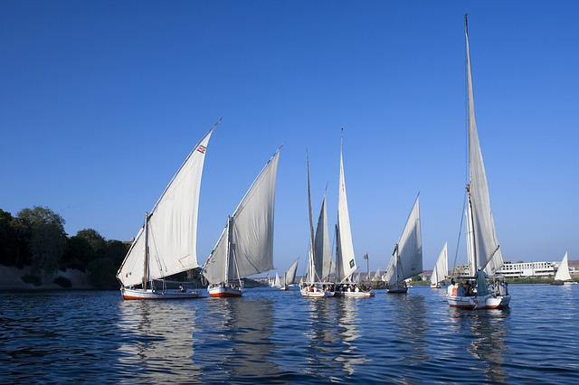 Free river nile egypt dhows blue sky reflections
