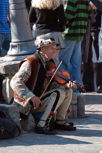 Free man elderly violin music poland street scene