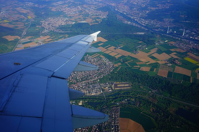 Free fly aircraft wing aerial view from above reported