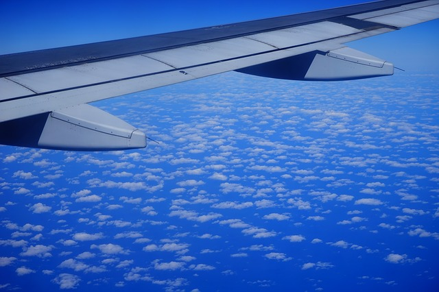 Free fly aircraft wing sky clouds blue