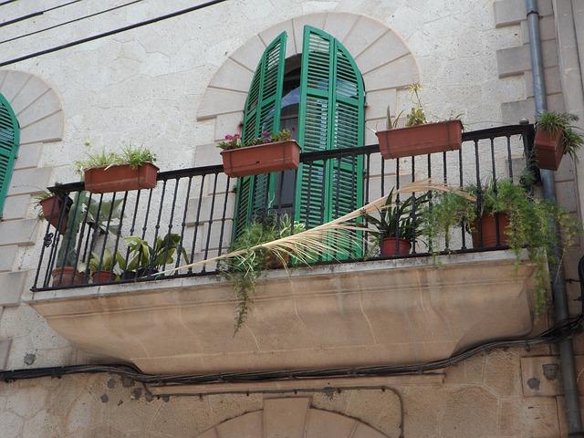Free balcony mediterranean gull wing doors facade detail