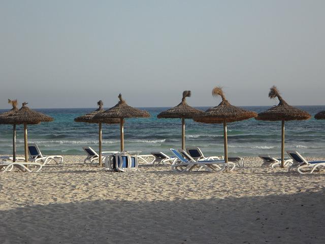 Free sun loungers parasols beach sand beach tourism