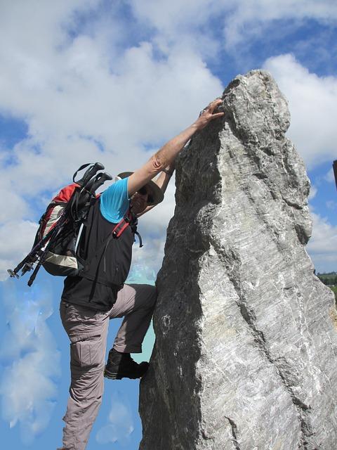 Free man person climb mountaineer rock steep sky blue