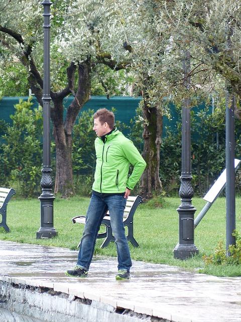 Free man wind windy forward storm hair jacket green