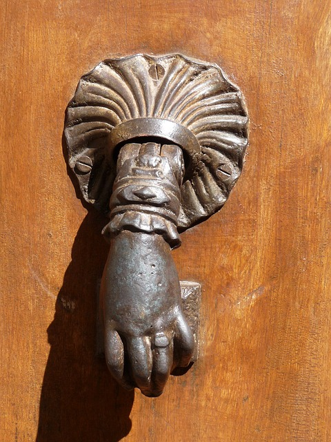 Free hand knocker antique