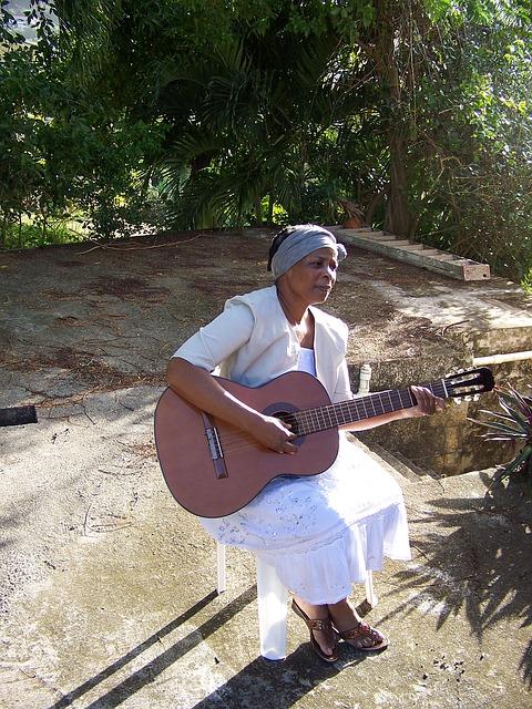 Free woman guitar female singing musical playing guitar