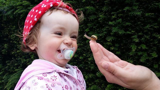 Free Photos: Baby small child laugh joy snail pacifier | Dirk Schumacher
