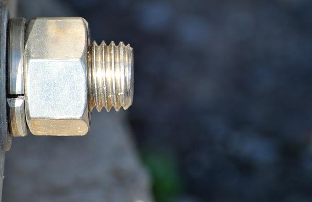 Free bolt metallic nut metal chrome steel macro shiny