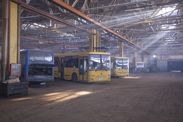 Free passenger bus repair shop plant hangar yellow