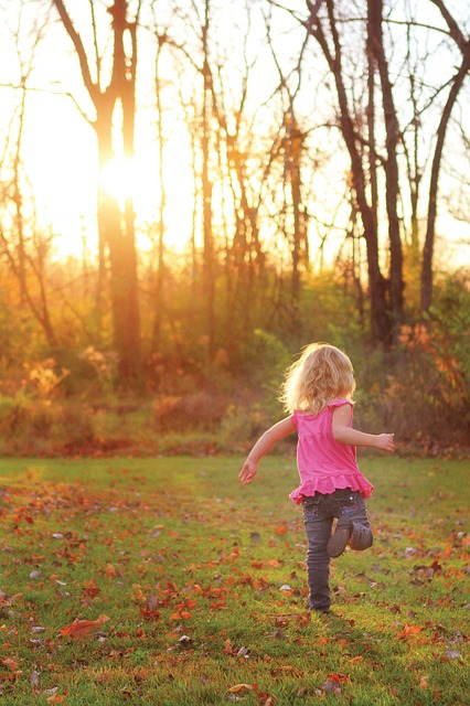 Free girl child running playing autumn trees field