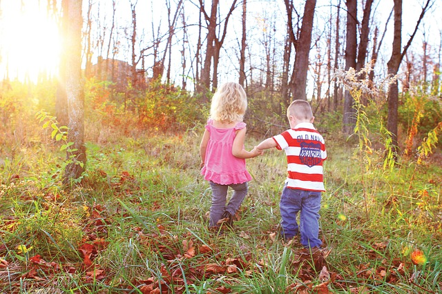 Free boy girl holding hands happy young autumn outdoor
