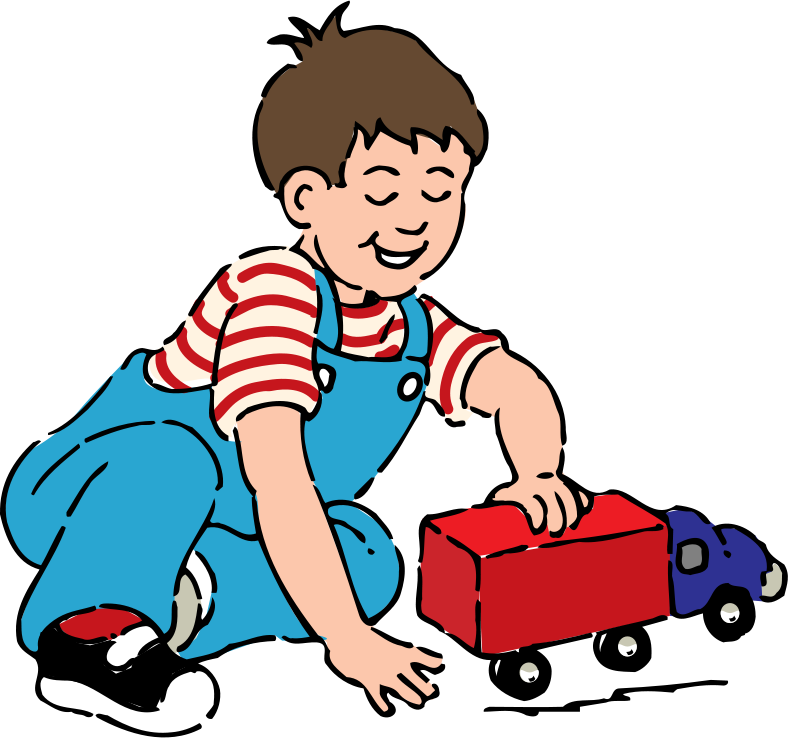 Free boy playing with toy truck