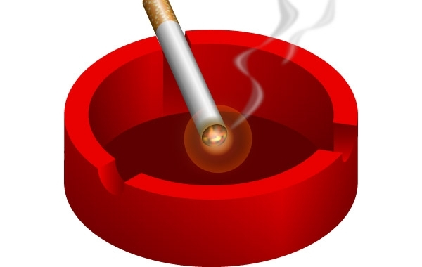 Free Ashtray with burning cigarette free vector