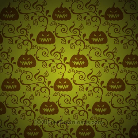 Free Pumpkin with leaves on green background