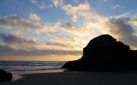 Free Sun Setting Behind Island Rock