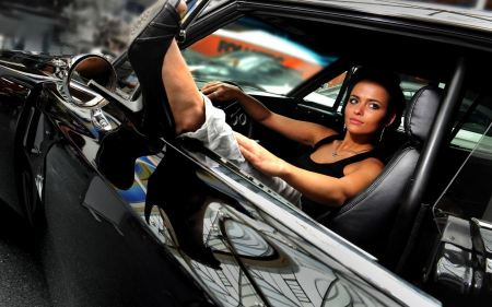 Free Woman Driving Muscle Car