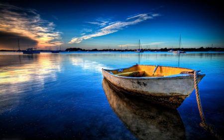 Free Sea Boat on Still Water Wallpaper