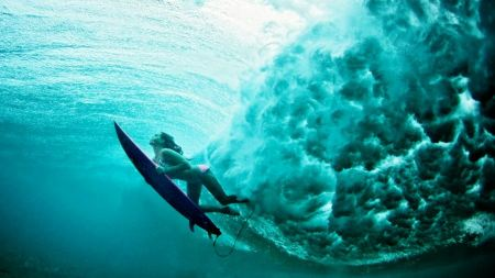 Free Underwater with a Surfboarder