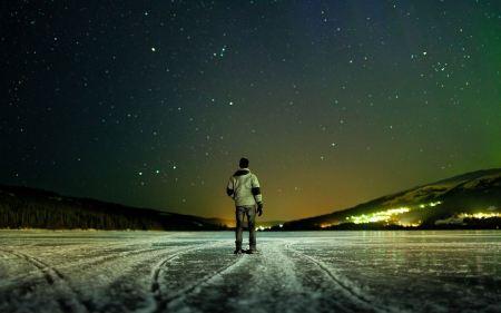 Free men standing on frozen lake